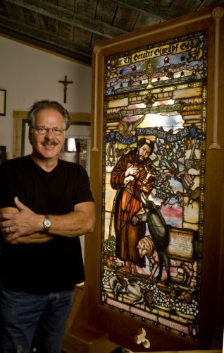 Stained glass artisan Charles Barone, of Basye,  stands beside his artwork, which was blessed by Pope Francis during his visit in September. Rich Cooley/Daily